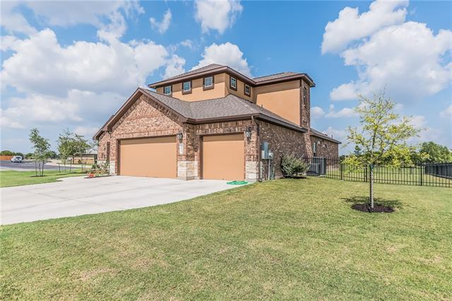 Shows like a model home; this 4 bedroom 3.5 bath 2 living home has 3 car garage, a gorgeous stone/stucco exterior and dramatic 8' ceilings with many upgrades and custom design features. A large study off foyer and open dining room to welcome your guests in style. Kitchen is equipped with SS builtin appliances and beautiful stone island. The spacious master bath is a retreat and features custom design. Backyard oasis has grill, fireplace and surround sound. Theater room offers wet bar and half bath.