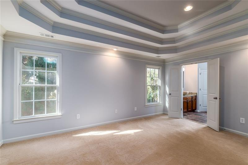 Absolutely spectacular master suite with triple trey ceiling & neutral paint palate throughout!