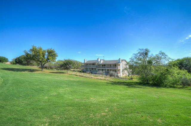 Watch the gorgeous hill country sunsets on the golf course just off your back porch. Located just minutes from the Cap Rock clubhouse and walking distance from the Ram Rock, this move-in ready town-home features new flooring, new tile, new appliances, new paint inside and new ceiling fans. This unit has a private balcony upstairs and a patio off the master downstairs overlooking the fairway of the Ram Rock Golf Course.