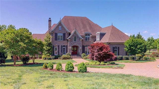 Square footage verified by 5/16/18. A phenomenal home, outstanding location off Rea Rd in south Charlotte!  Custom designed, features include a grand entry curved staircase, living room w/antique hand made mantle and surround, large formal dining room.  Centrally located elevator for all three floors (3rd floor is over-sized attic)  Impressive kitchen area opens to great room.  Large granite island w/chandelier, abundant cabinetry, walk-in pantry.  Informal dining room        w/panoramic view of back yard, plus access to a covered porch and a separate porch for grilling. Master suite truly is a retreat: over-sized sleeping & sitting areas, over-sized bath, and over-sized closet.  4 upstairs bedrooms: 2 en suite and 2 are jack & jill. 2nd floor family room plus large bonus room.  Fixed stairs to attic- could be additional  living space and still have storage!  Foam insulation means only 6-8 degree difference in temperature between heated and unheated areas.  A very livable floor plan!