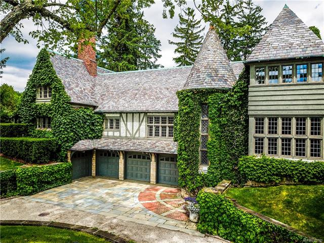 Landmark Wallace Frost home situated on 3.2 acres of rolling grounds & meticulous landscape.  Perched w/tree top views and private gardens.  The positioning and posture complete the privacy of this enchanting estate.  The inviting foyer opens to a large living room w/fireplace, floor to ceiling windows and access to a 4 season room w/fireplace. 2 story first floor master wing is complete with paneled office, large walk in bath w/dressing area & circular stair to additional seasonal closet.  The updated kitchen includes a Traulsen refrigerator, commercial cooking equipment, eat- in w/storage, butler's pantry w/ built-in refrigeration & sterling prep sink. Casual living spaces surround the kitchen nook. Artistic expression is seen throughout, including an all season dining room w/garage style doors for open flow to the brick enclosed garden with water feature.  Second floor bedrooms and suites with additional sitting area and 4 car garage, complete the lifestyle of this romantic oasis.