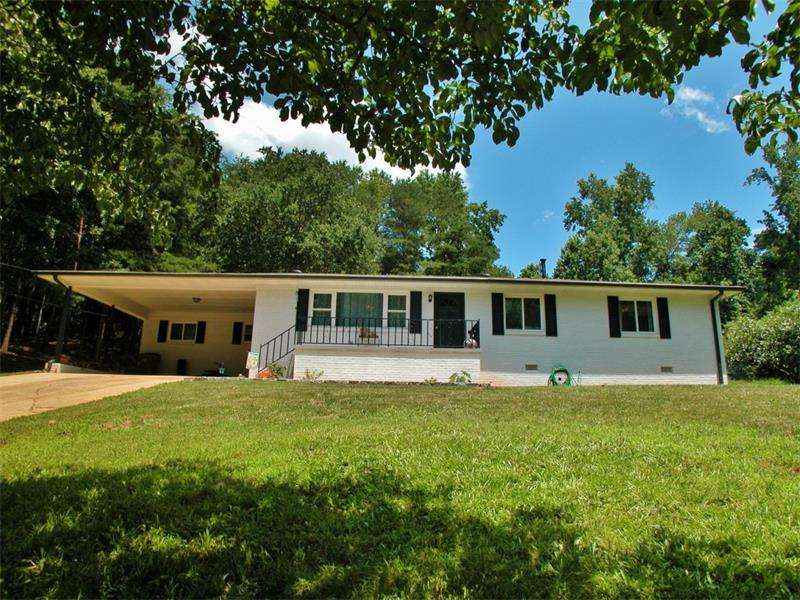 This brick ranch is adorable! So much space! Hardwood floors, granite countertops, dining room, living room, den with stone fireplace, 3 bedrooms, back deck, and so many quaint details. Very close to Robinson Park!