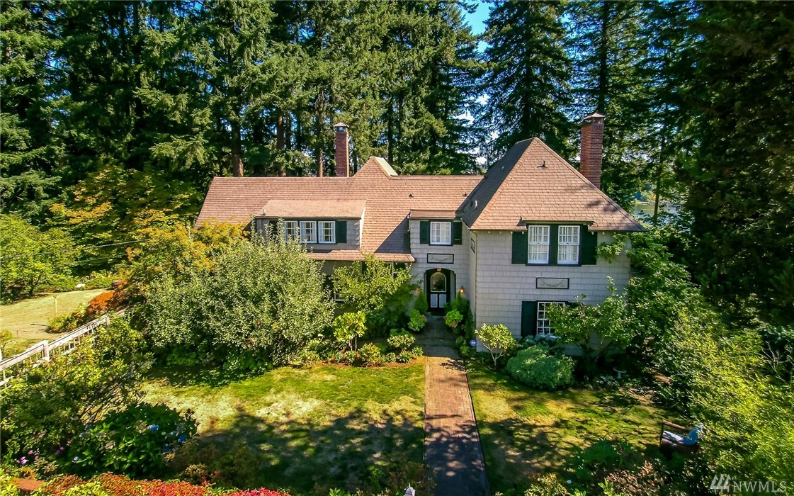 Historic masterpiece w/views of Capitol, Lake, Mt. Rainier, city. Aristocratic from every angle. Antique/history buffs dine where General Eisenhower dined. Imposing stateliness w/ cherished renovation guided by original architectural plan. High end custom & period features. Historic registry due to prominent persons & jurists. 4 BR, 2.5 BA. Updated kitchen w/marble counter tops. L.R. fplc tiles by Vermont artist. Italian glass fl. . Sport court, .99 ac.Privacy, proximity, elegance. Lush Gardens.
