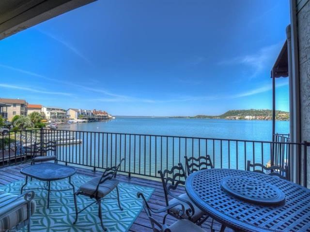 A Beautiful East facing, open water townhome located in the heart of Horseshoe Bay Resort. (Separate Membership needed for Resort) 4 bedrooms/5 baths & bunk room. It has an open floor plan w/large living room,dining room & kitchen all with Eastern Open Water views. Master with its' own private balcony, inside lounging area & large bath w/newly remodeled shower. Enjoy the lake with your enclosed boat slip/lift, nice deck area & wave runner lift. 2 car garage-extra storage area & plenty of guest parking.