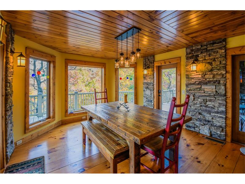 This stunning custom home offers a modern interpretation of Craftsman architecture. Gorgeous hm feat. a long private drive w/3 level of decks to enjoy the beautiful views. Main level feat open floor plan w/plank pine floors, custom stonework, lighting & chefs kitchen w/custom cabinetry & views to great rm w/27 ft stacked stone FP, sep dining rm, butlers pantry & screened in porch. Upper level w/loft,  mstr suite w/stunning mstr bath, sitting rm & private balcony. Terrace level feat. in-law ste w/full kitchen, dining & living space, 2 BR w/sitting areas, 1 w/FP & 2FB.