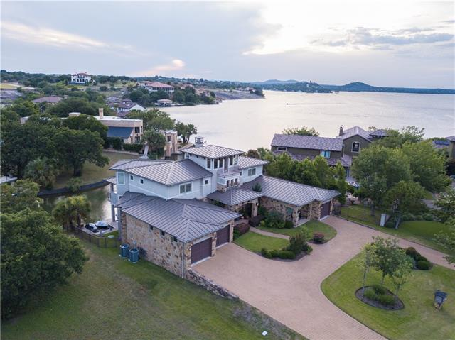 SPECTACULAR VIEWS of Lake LBJ from nearly every room. Bring a big family or friends to enjoy lake living at its finest with room for 2 boats & 2 jet skis! Entertainer's dream with a chef's kitchen, large deck to catch sunsets, oversized hot tub, theatre room with projection system and game room with wet bar overlooking the lake. Applehead Island is private & gated, offering 24hr security. Neighborhood amenities include a resort-style pool and tennis courts.