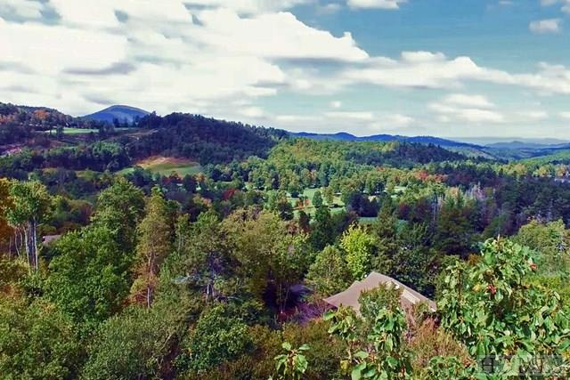 Find yourself nestled among treetops, secluded in your own mountain retreat that only the charm of the mountains can provide. Make your vision a reality by owning two new lots located inside the gates of the prestigious Old Edwards Club. Combined lots, 13 and 14 have a desired proximity to both the clubhouse and the main gate and sit on a very private street, making the location unmatched! These lots provide the best of all worlds, featuring exceptional mountain, golf course, and lake views! This is deeded as a double lot with one HOA fee. Sewer and water hook up already paid.  The topography of the land has proven these lots to be very buildable—bring your plans!
