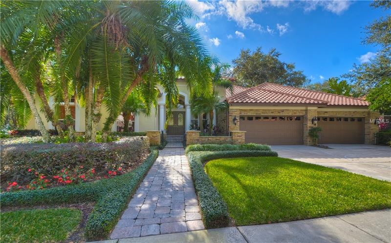 Beautifully remodeled home in sought after gated neighborhood of Tampa Palms. This luxurious home has 4 Bdrms/4.5 Baths/ Office/ Family Rm/ Living & Dining Rm/ Game Rm/ Bonus Rm/ & 4 Car Garage w 2 Lifts that can fit 6 Cars. Great curb appeal w conservation in the back & on the side, over sized lot, lush landscaping, outdoor lighting, stone accents, new barrel tile roof, brick paved walk way & front porch, and wrought iron fenced courtyard. The double door entry welcomes you into this lavish home w soaring 12' recessed ceilings, faux paint, new travertine floors, 8' doors, detailed wood work including crown molding, high baseboards, chair rails & wayne's coating, opulent lighting & fans, and custom window treatments. Expansive master bedroom w bay windows, walk in closet, double vanities, garden bath, and 2 shower heads. The gourmet kitchen boasts striking granite counters w beveled edges, an island, breakfast bar that seats 6, staggered solid wood cabinetry w crown molding, recessed lighting, and clear glass inserts, induction cook top, double oven, and custom wood front dishwasher & refrigerator. The gorgeous addition includes a game rm w fresh water aquarium, a bonus rm that soars 20' high w floor to ceiling windows & magnificent wooded views, and an upstairs 4th bedroom w extra storage & full bath. Spacious family rm w a gas fireplace & triple sliders leading to the huge lanai w screened enclosure, brick pavers, updated salt water, heated pool & spa, and wood deck in the back for outdoor gatherings.