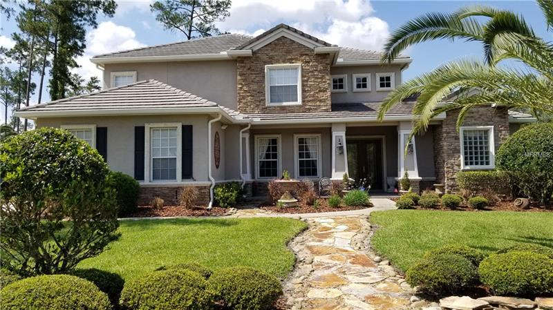 Custom two story home in the desirable gated community of Magnolia Plantation.  This golf front home has terrific views of the 4th green, sand trap, pond, and the Wekiva Preserve Conservation area.  Great location on a quiet cul-de-sac.  First floor features a Master Bedroom suite which includes a private sitting area with corner, marble faced fireplace and awesome pool views.  Master Bathroom has separate vanities, glass enclosed shower and whirlpool tub.  Large master closet with custom organizers.  Formal dining room and two story living room.  Great kitchen with large center island, granite counters, stainless appliances, designer tile,  walk in Pantry, and Breakfast Nook.  Kitchen overlooks family room and opens to the pool and lanai.  Butler's Pantry/Wine Bar and easy access to large storage under the stairs.  All baths and laundry room (with sink) have granite counters.  Staircase entries from Kitchen and Living Room lead to the second story with large open loft, four bedrooms all w/custom closet systems, two bathrooms, and screened balcony overlooking the pool.  The screened in pool (solar and gas heated) and lanai have travertine tile, rock waterfall and wall, and exterior half bath.  Three car side entry garage, tile roof and oversized 7 inch gutters.  Community has park and tennis courts.  Entry is guard gated.  Great Seminole County Schools.  Easy access to I-4, shopping, restaurants, parks and the Seminole Wekiva Recreation Trail. Living Room Chandelier does not convey but is negotiable.