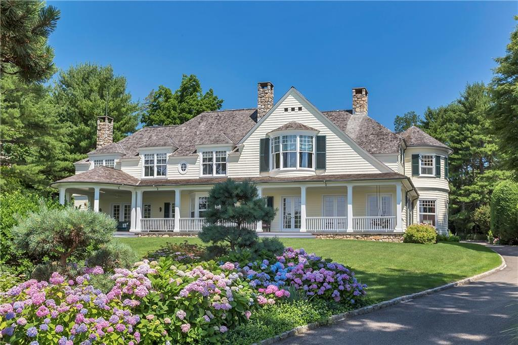 This Belle Haven Association custom built shingle-style home is ideally positioned to capture the spectacular and dramatic views of Great Captain Island and across Long Island Sound. The floor plan was designed to provide incredible water views from every room. The modern construction of the 5-bedroom home includes high ceilings, oversized windows, cherry floors and expansive covered porch. The detached garage includes; 2 bays, a guest suite, office and pool house. The beautiful sloping lawn leads up to this gracious waterside home with a private pool area in the back is wrapped in magnificent gardens. Truly a once in a life time opportunity to acquire a front row position in Belle Haven.