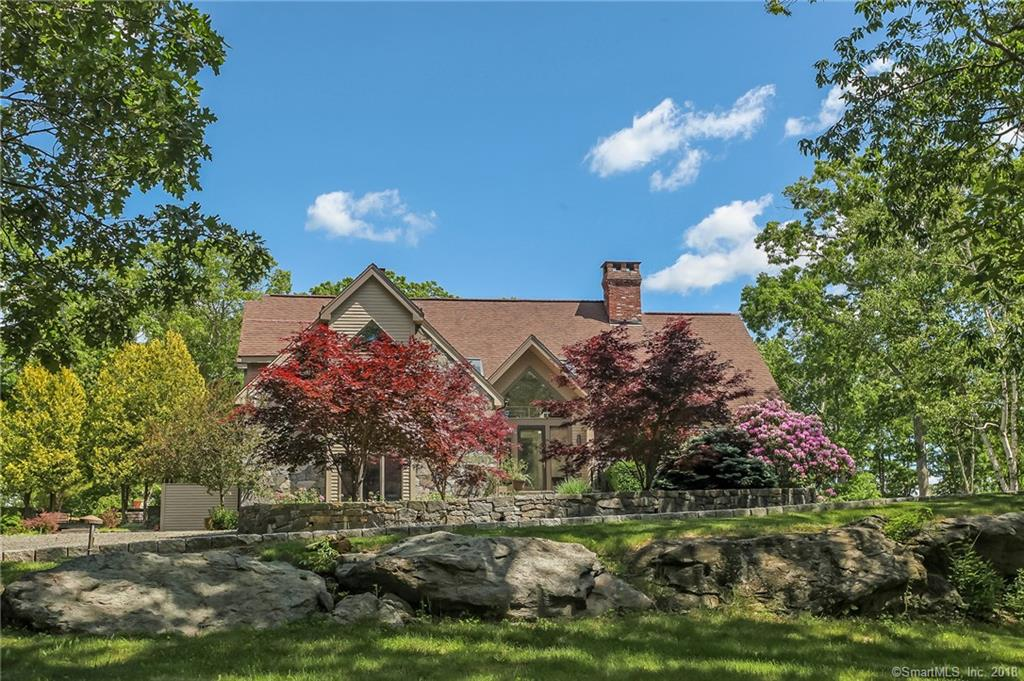 Just 90 Minutes from NY! Architecturally Stunning Estate in the desirable Golden Harvest Area of Roxbury. The hilltop setting with 280 degree views of the Shepaug River Valley offer a quiet and private oasis with gorgeous heated gunite pool with bluestone terrace overlooking views of foothills and nearby farmland. This architect designed stone and clapboard home is set up for easy living with it's open concept plan and soaring ceilings. The 4 wood burning fireplaces, floor to ceiling windows, french doors to outside entertaining space complete with built-in grill. The screened porch overlooks the pool and rock outcroppings, ledge and Laurel. The lighted driveway meanders in to the private setting. The grand foyer opens on to the living room with soaring ceiling, grand fireplace and a cozy dining room with fireplace. The heart of the living space is the great room with stone fireplace which is open to the updated kitchen with custom cabinetry, granite counters, 40 inch gas range and stainless appliances. The master is on the first level and there are 3 additional bedrooms on the uppper level. The lower level is finished with space for a game room, media room or gym.  All the luxury with the ease of modern living!