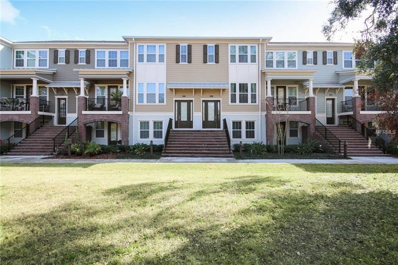 **Live in sought after Oviedo on the Park.** Enjoy a low maintenance lifestyle in this fully updated move-in ready townhome! The open kitchen is a culinary masterpiece boasting **GRANITE COUNTERTOPS, STAINLESS STEEL APPLIANCES, AND DARK 42 INCH CABINETS FEATURING STYLISH SUBWAY TILE BACKSPLASH**. Meticulously maintained 3-story, 3 bedroom/3.5 bath home offers a large private guest suite on the first floor with a full bathroom for multigenerational living or perfect for guests. The spacious master suite is a private getaway with a walk-in closet and the master bathroom featuring dual sinks and two shower heads. The living room features large windows that exude plenty of natural light, creating a bright and airy aesthetic. Relax after a busy day in the lovely balcony, plus take advantage of the spacious 2-CAR GARAGE! Walk to Oviedo on the Park and enjoy the plethora of activities they offer- concerts, movies in the park, monthly food trucks, dog run, splash pad and community pool for everyone.  Your new townhome is in an ideal location convenient to 417, the Oviedo Mall, A-rated schools, Oviedo Hospital, Winter Park, UCF, and Seminole State College. You will be IMPRESSED, don't miss the chance to make this beautiful home yours!