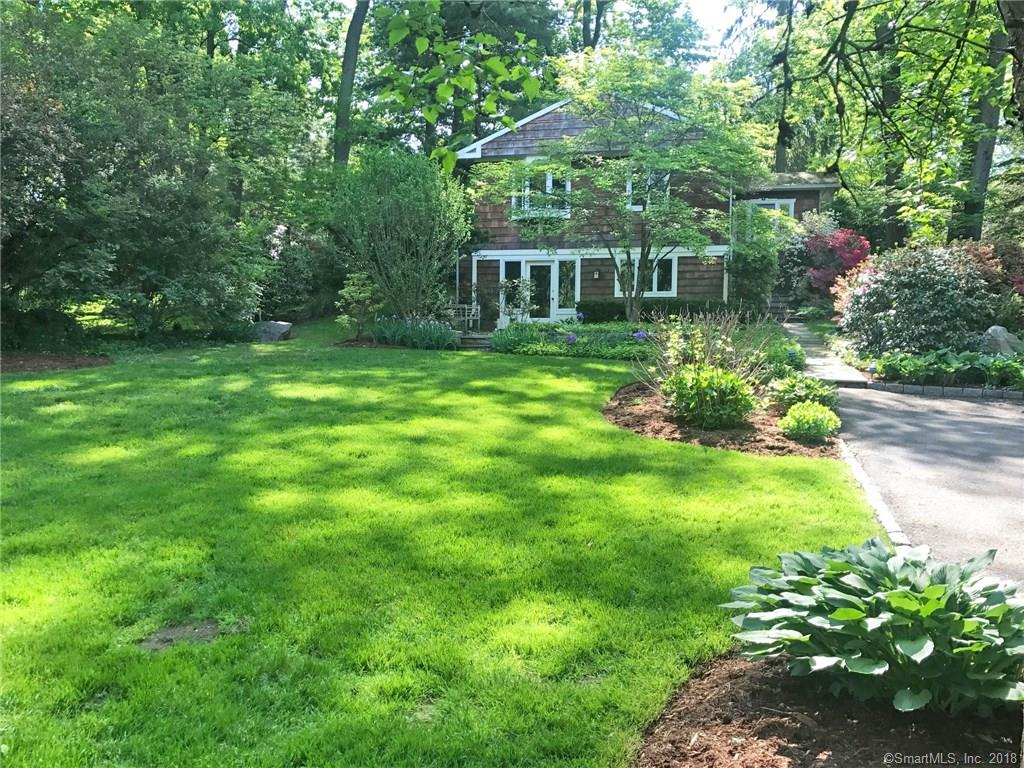 A secluded and private Rowayton gem!  This charming 3 bedroom, 2.5 Bath, 2200 SF home is nestled on a hard to find .40 acre property at the end of a quiet cul de sac close to town. Featuring perennial gardens, stone walls and a decorative pond, this home is within walking distance to all Rowayton amenities - town, schools, beach and library. 2 Bedrooms and 1.5 Baths on one floor, 1 BR and full bath on another floor offers flexible living. Wonderful as is, or can be added onto if desired.