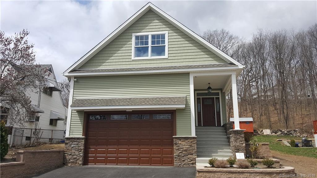 Gracious home with charming craftsman style accents. Open bright living space. Soaring vaulted ceiling. Excellent home for entertaining. Hardwood floors throughout. Upgraded kitchen. All three bedrooms have en suite bathrooms.  Very easy down-county and NYC commute.  10 Min to LI ferry, Metronorth express service, Acela, AMTRAK.  New casino coming soon.  Easy to lovely Beardsley Park.