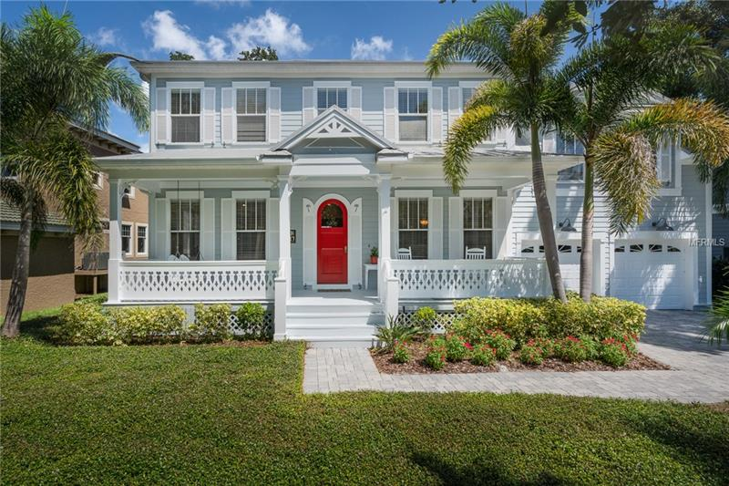 "Fall in love with this elegant, South Tampa WATERFRONT home.  This KEY WEST design has a large front porch overlooking the park-like front yard.  The downstairs features a formal library, dining room, family room, kitchen with granite countertops, stainless-steel appliances, gas range, and butler's pantry.  All four bedrooms are upstairs.  One of the secondary bedrooms (20x18) is currently used as a HOME THEATER ROOM with built in murphy bed, full bath, and retractable 80"" Home Theater System with surround sound -  could easily be used as a SECOND MASTER SUITE.  Wait until you see the master suite with private sitting area, gorgeous master bath and private balcony master overlooking the water.  The backyard is AMAZING with two porches (one screened lanai, one open deck), lush landscaping and fire pit with custom paver walkway.  The gas grill is connected to natural gas and has an outdoor shower.  Feed the manatees or fish from your FLOATING DOCK in your own back yard! The home has an unobstructed view of the Island and Spring Lake with direct access to Tampa Bay.  *Note – low bridge between the home and Bay*.  A rated Mabry/Coleman/Plant Schools. Canal was recently dredged and the City of Tampa just finished a long term drainage project to alleviate street flooding issues."