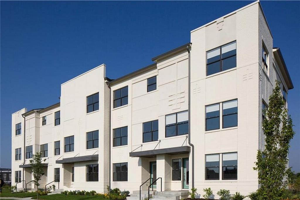 Welcome to your new home in the Village of WestClay where you'll experience a maintenance-free lifestyle. This new townhome features smart style and features for today's buyer including solid surface counters in the kitchen and baths. 9 foot ceilings on all floors make the spaces feel open and large. There are 2 bedrooms on the upper level each with their own bath. The laundry is also on that level. On the main level, the floor plan is open with an island in the kitchen for seating as well as another area for dining. The living area is open to those areas as well. On the entry level is a flex space. Heated, 2-car garage with opener. The mechanicals including high efficiency HVAC & 50 gal. hot water heater. Enjoy life in the Village.
