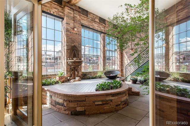 Live out your urban fantasy!  Modern luxury meets the beauty of the past in this historic, loft-style condo in the heart of LoDo.  Overlooking lively Market Street with views of Coors Field, this architecturally stunning condo boasts 4 bedrooms and 5500 square feet of living space, all on one level. With a rare 3 car attached garage with wide private indoor stairs leading to the living space as well as private front and back entrances, you can literally step outside your door into vibrant Lodo and walk to sporting events, theaters, cultural attractions and the best shopping and dining Denver has to offer.