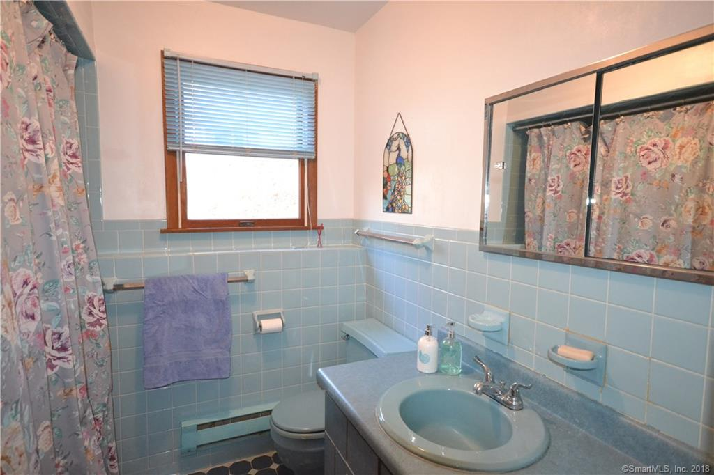 EXPANSIVE waterfront home with gorgeous views and 67 feet of waterfront facing south.  The open floor plan makes entertaining easy.  The great room has soaring ceilings and a stone fireplace and loads of natural lighting. The country kitchen,  dining room and huge great room have access the oversized deck with lake views.   The main level has a master suite with full bath.  The lake level has 3 additional bedrooms, a full bath. The lake level family room has a warm fireplace, office area and a large sunroom with gorgeous lake views and access to the level, private yard.  Enjoy lake community amenities of 2 beaches, clubhouse, tennis courts, and hiking trails.  The community is located close by all conveniences and an easy commute to Westchester and Midtown Manhattan.