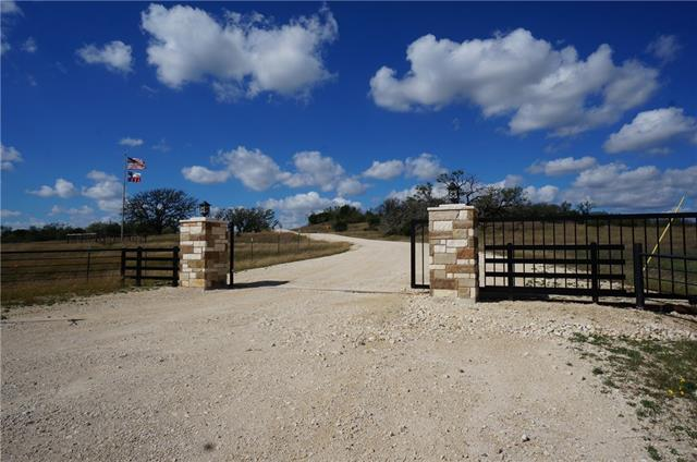 "10.56 Acres in a gated community. Beautiful Land- One of the 1st resale properties in this development. Located on the cul-de-sac street (off the beaten/main road.  Ready for you to enjoy the sunrises and sunsets. Create you peaceful ""Ranch"". Located about an hour from Cedar Park/Leander and less than 1 hour and half from Austin. 300+ Feet of road frontage with a level building site and a slight drop to allow you to enjoy the ""hills"". Owners plans have changed and this is his sacrifice- your gain!"