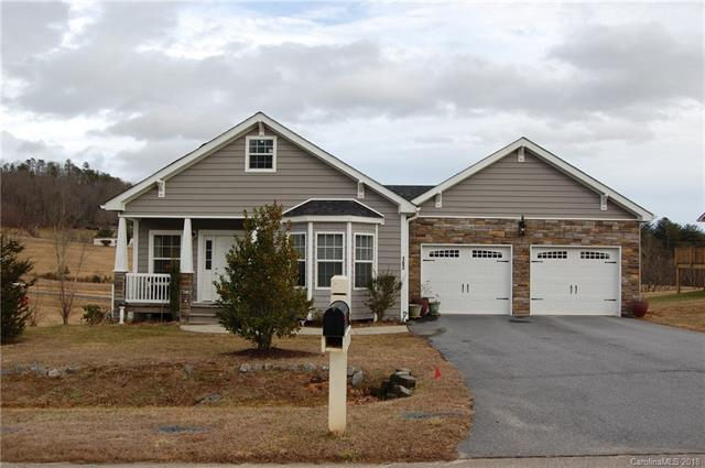 This beautiful home is located in the desirable Etowah valley and features pastoral and mountain views in the quiet Waters Edge community. An immaculate, one owner home with 2 bedrooms, 2 baths, a cozy fireplace and open kitchen with lots of cabinets. Single level living with only 2 steps into the home. Oversized 2 car garage with much room for storage, plus massive additional storage space in the unfinished attic. This home has crown molding throughout and beautiful wood flooring in the main living area, kitchen and dining room, carpet in both bedrooms and ceramic tile in both bathrooms and laundry room. Paved private streets and driveway for clean and easy access. 35 year architectural shingles, easy maintenance vinyl siding with cultured rock inlay makes this home virtually maintenance free. Etowah is the perfect central location convenient to Brevard, Hendersonville and only 20 minutes from the Asheville airport. This home is a must see!