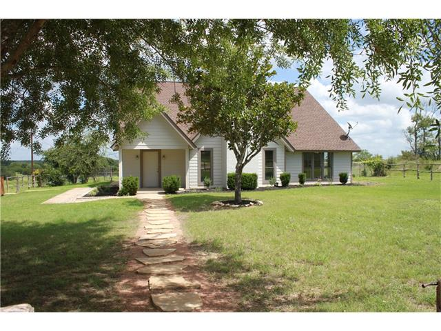 AWESOME COUNTRY LIVING!!20 ACRES (can be sold with 36 acres), privacy/awesome views-2 ponds/mature oaks,backs to huge ranch.Great for contractor/home based business/horses.Home remodeled,4 bedrooms-3.5 baths,2 car detached garage/workshop,formal dining,perimeter/interior fencing-new updates include custom kitchen cabinets/granite counters/stainless appl,master suite has new jetted tub/separate oversized custom tile shower,huge walkin closet,hardwoods/tile floors.Comm pool and fishing tanks