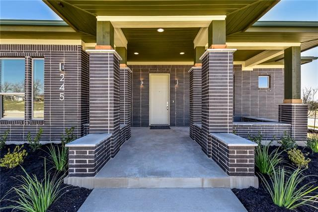 Mid Century meets Modern! Home boasts of over sized dark exterior bricks w/ XL porch columns, high end ultra modern light fixtures, SS Jenn Air appliances, engineered hardwood floors, arched doorways, single bay apron front kitchen sink, dovetailed drawers, chrome pot-filler & hand crafted baseboards. Home sits on a corner lot w/ side entry garage & has both covered front & back porches! Fully landscaped/irrigated yard w/ backyard fully fenced! All 4 bedrooms are each attached to a full bath w/ granite!
