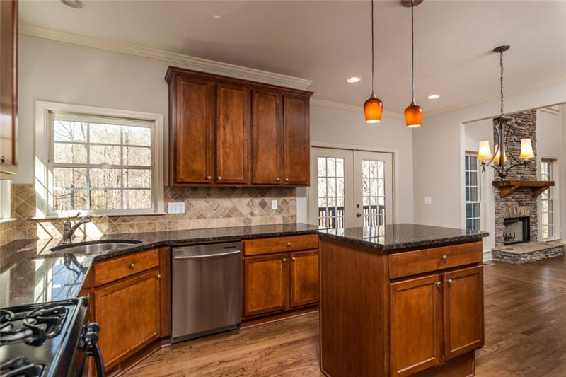 Spacious gourmet kitchen with plenty of counter space for food prep & serving!