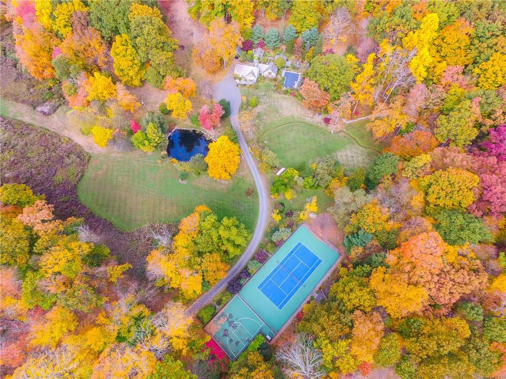 One of Newtown's most iconic properties is now offered to market for the first time in over 30 years! On more than eleven park-like acres with a varied terrain of rolling hills, light woodlands, reflection areas and peaceful garden spots this private compound features a main house w/beautiful exposed stone walls, formal dining, family room w/fireplace, gourmet custom kitchen, office suite over the garage & spacious master suite w/spa-style bath. Slate-roofed guest house provides a wonderful venue for entertaining & sleeping with its welcoming fireplace, kitchenette & full bath. Secluded, yet close to town and shopping this property is a recreational paradise w/its lovely saltwater Gunite pool, tennis court & basketball/activities court!