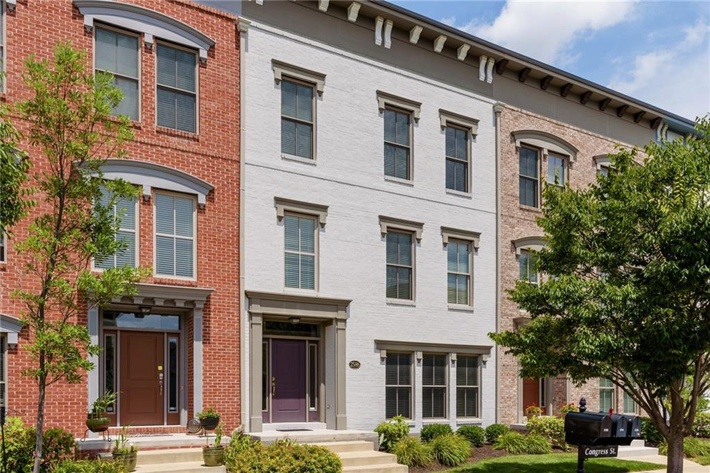 "Luxury living on this beautifully maintained Urban Brownstone! Gorgeous 3-story featuring 3 bedrooms, 2.5 baths, upgrades fit for your custom lifestyle starting on main level with rich, dark hardwood floors thru-out, wrought iron stair rail, great Kitchen w/ stainless appliances, upgraded cabinetry,  Large Master Suite with soaring cathedral ceilings, amazing tile, dual ""comfort height"" vanities & huge walk-in closets.  This open concept unit also features a Hearth room(flex room) with fireplace adjacent to kitchen. 2 Car Garage and oversized balcony. Enjoy Village of West Clay lifestyle in  Carmel's most desirable neighborhood!"