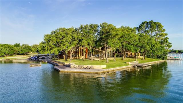 Lake LBJ's #1!  Eagles Point in Blue Lake Estates (Horseshoe Bay) is a 6 bedroom, 4.5 bath architectural masterpiece nestled on the best tree-studded Peninsula with over 400 deep waterfront feet on Lake LBJ.  This Webber + Studio rebuild is in a class of its own with the most unbelievable panoramic views money can buy.  Materials such as pecky cypress and onyx counter tops throughout will blow you away and the floor to ceiling glass bring Lake LBJ right inside this one-of-a-kind estate.