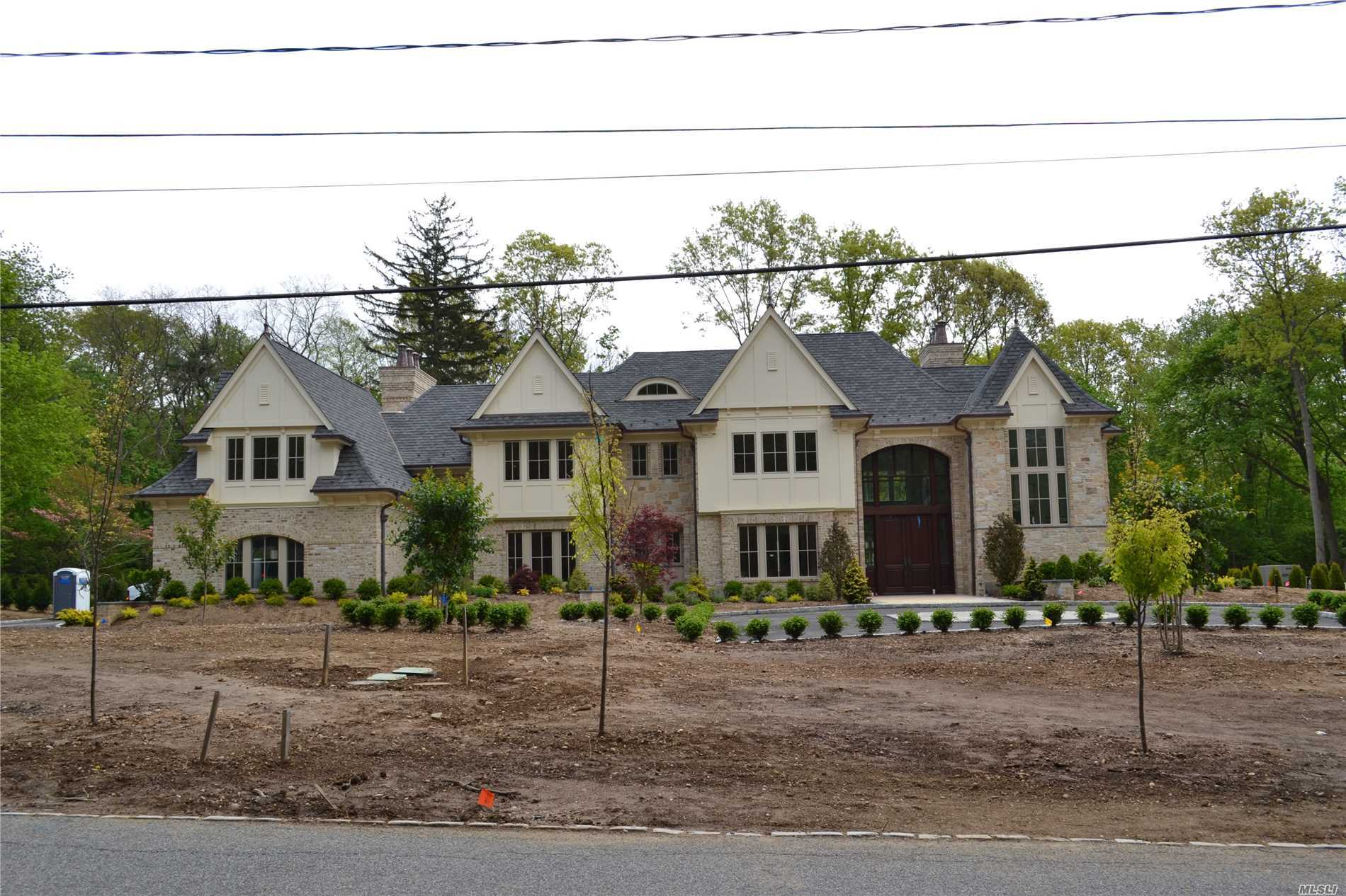 Exquisite New Construction Built By Highly Acclaimed Napoleon Development. Situated On A Spectacular 2 Acre Flat Lot, This Home Will Offer Exceptional Luxury Living With Refreshing And Modern Appointments. Highly Detailed And Refined Crafted Home Features Handmade Brick, Full Bed Stone, Elevator, In Ground Pool And Incorporates A Sensible Open Floor Plan.  Finished Lower Level With Sauna, Bar, Gym, Theater Room And Wine Cellar.  Jericho Sd.