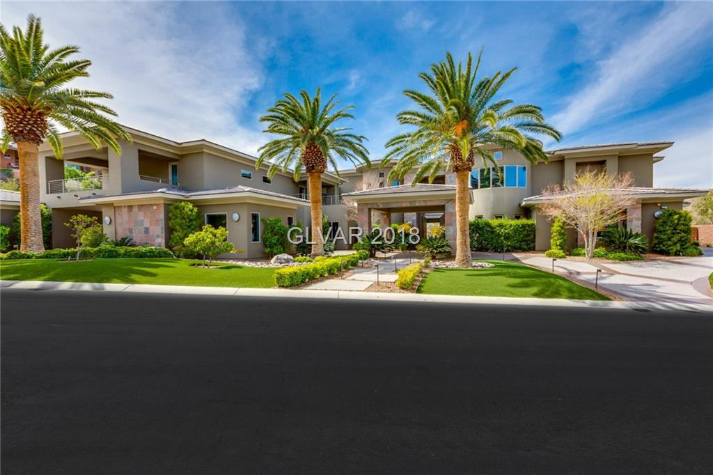 This contemporary estate is absolutely incredible! FULL STRIP, GOLF & CITY VIEWS! 7 master bdrms including detached casita, 8 car garage(4 climate controlled); gorgeous interior design; theatre can seat 18-20; gym or dance room w/rubber floor; office; ultra lounge, Zen crtyd, billiards room w/ wet bar; exceptional chef's kitchen+ catering kitchen+ outdoor kitchen; disappearing doors to oasis backyard; huge balcony; home automation + security