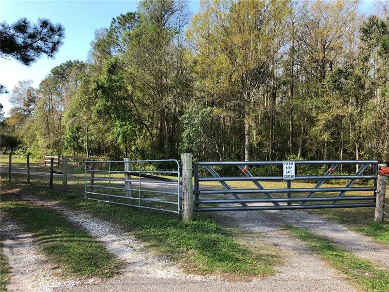 BRING ALL OFFERS! This 11+ acres is a hidden sancuary ready for your dream home or development.    6.64 acres are Cat 1 Wetlands that must be preserved but the additional 5 is ready to be built out. There is currently a horse barn and a mobile home on the property but very easy to show.  Don't miss the chance to own a piece of the fast growing Odessa area.