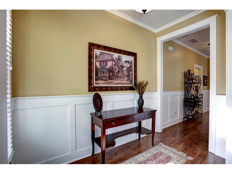 Another view of the entrance shows the custom door casing, paneling and crown molding.