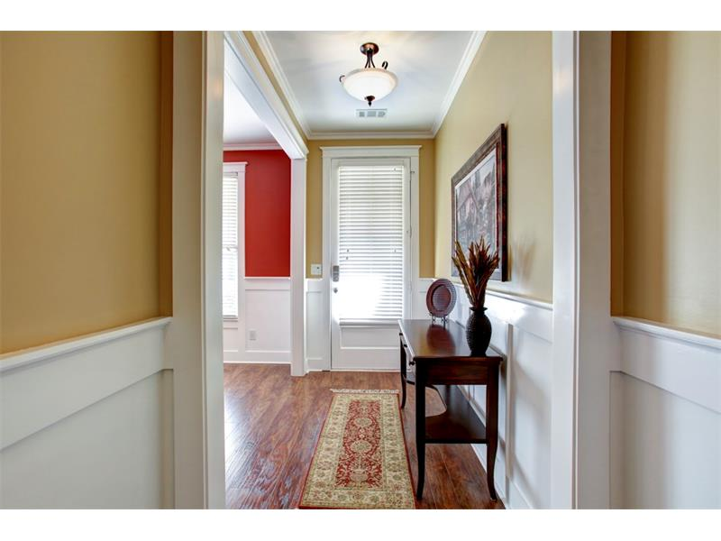 The entryway to the home connects to a versatile front room. The seller uses this room now as a dining room but this could easily become an office, playroom or separate den.