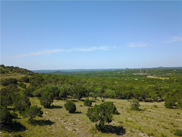 Unrestricted! Enjoy the 20 mile views to the west & southwest overlooking the Wimberley/Blanco River Valley! This secluded 3 acres is perfect for someone who wants privacy and convenience.  You're within 3 miles of downtown Wimberley, Jacob's Well, and Blue Hole Regional Park! Multiple building sites to choose from. Has flat area at the bottom, tank, and hillside. Perfect for multiple uses. Gate unlocked. 4,5,6 and 12 acreage options.