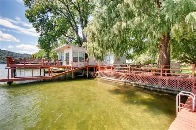 Luxurious LAKE FRONT lot in desirable Lake Austin community. Guest house at the water and the dock is ready for your boat! The extended deck is overlooking the water. Neighbor to Ski Shores! Build your dream home on this park like setting oasis on beautiful Lake Austin.