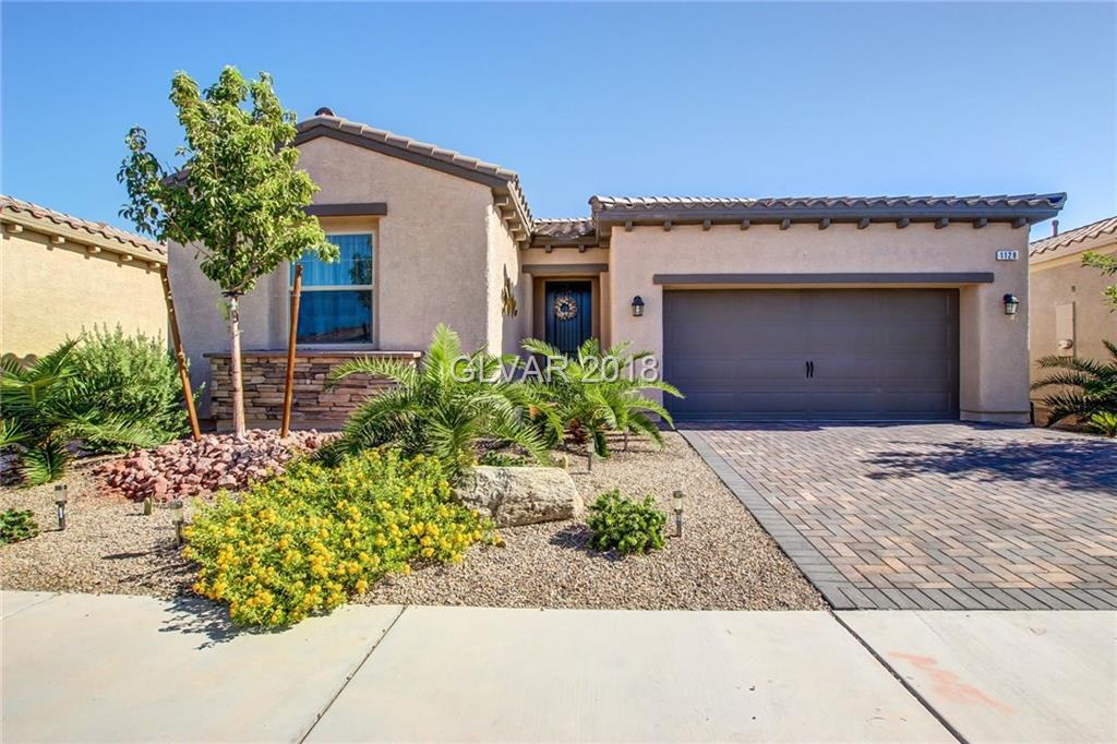 Spotless single story in guard gated Tuscany Village golf community! Perfect kitchen w/large island and dark cabinets open to bright great room. Large master w/walk in closet, Master bath w/ dual sinks and oversize shower. Tankless water heater. Paver drive way and pavers in covered patio. Tuscany Village is minutes from the World Famous Las Vegas Strip and water sports at Lake Mead and Cowabunga Bay Water Park. Don't let this dream pass you by!