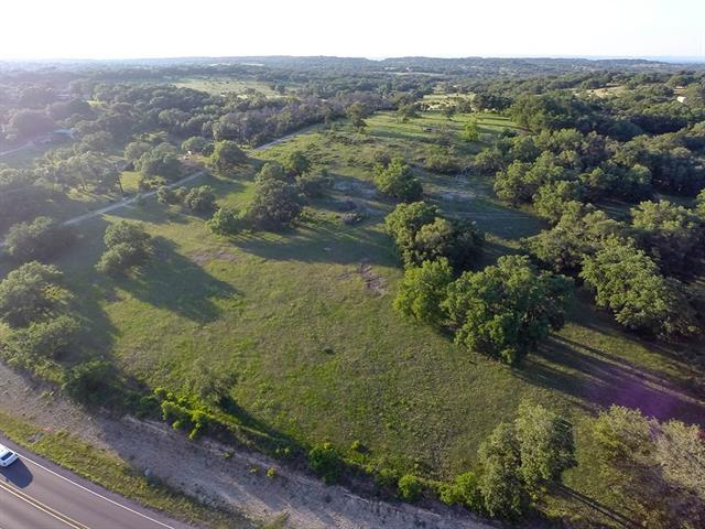 19.207 acres with so much potential!  Hill Country views for miles and miles.  Limitless possibilities with no restrictions, not in ETJ.  Seasonal pond with potential stream.  Massive oak trees throughout.  Small shed with enclosed fence.  Survey on file.  1800' road frontage!  YouTube aerial video available upon request.