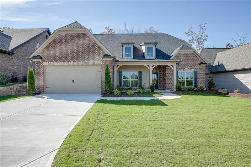 This 3 sides brick ranch plan is single level living at its finest! Right off the foyer is formal dr ideal for gathering w/friends & family.  Open great room showcases a gorgeous fireplace. Gourmet kitchen features an elegant island, walk-in pantry, upgraded ss appliances, & breakfast area. This plan features 2 secondary brs & a full br on one side & the dramatic owner's suite on the other side of the home, providing the perfect amount of privacy. The owner's suite features a spa inspired br w/dual vanities, granite countertops, garden tub, & a massive walk-in closet.