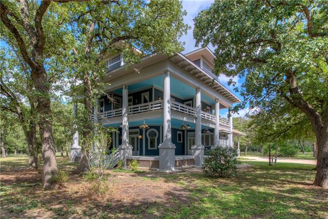 Historic Walton Mansion. Built in 1897 as wedding gift to Walton family. Rich solid oak woodwork, custom milled details along with hand crafted stained glass windows more than 100 yrs old adorn the home. Lovingly updated in period style with over $215,000 worth of improvements. Located on almost 20 acres just 14 miles east of Austin. Tree lined & wooded lot along publicly maintained road close to amenities. Enjoy view from the 2 wrap around porches. Endless possibilities for this one of a kind property.