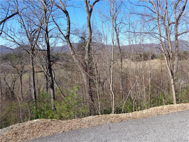 Outstanding mountain community located just 7 miles to historic DT Hendersonville and 5 miles to I-26. Near Perfect setting between two existing homes with mountain valley views - as well as long range views. Paved roads, city water avail. community clubhouse-fitness room-event room-seasonal pool-pond and more. This is it - Seller Motivated -over 50K below assessed value!