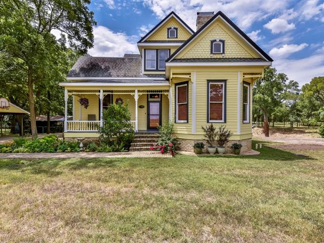 Original home built in the 1890's per owner, and moved to site.  Then remodeled and added on in early 2000's with impeccable detail. Bring your horses.  This lovely home backs to Cottonwood Creek, and the acreage is bordered by Brushy Creek.  Main house has over 4300 sq ft per owner. 