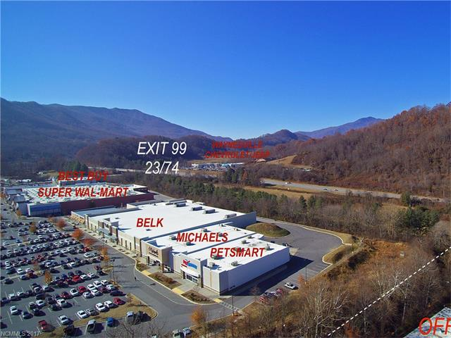 Remarkable location and opportunity adjoining Waynesville Commons (Super Walmart Center) with 27+ acres and over 389,800 square feet in office and warehouse with rail service. Updated environmental, roof, wet/dry sprinkler system, and more. Prime location for future development, bordered by Ingles, PetSmart, and more. Owner financing available.