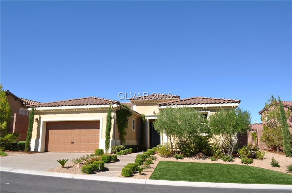 Stunning 1-story built by Pardee Homes in gated community of Lake Las Vegas. Courtyard entry w/large fireplace.Spacious gourmet chef's kitchen w/granite counter tops, tile back-splash & stainless appliances.10 ft ceilings.Master bath features granite counter tops, tile flooring & spacious walk-in closet.Additional Bedroom could be used as MULTI-GEN quarters w/sink, mini-fridge & microwave.Home has lots of upgrades & Backyard has poolsized lot