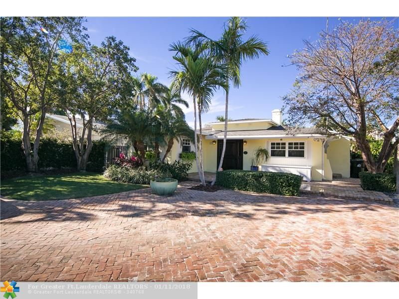 Enjoy this beautiful beach cottage home located in sought after Las Olas Isles. Located within walking distance of the beach and best restaurants in Fort Lauderdale. This 3 bedroom 2 bath home with large office is the perfect buy. Cook in your gourmet kitchen, have coffee at your breakfast nook or read by the fireplace. This home has all the comforts and more. Priced to Sell!
