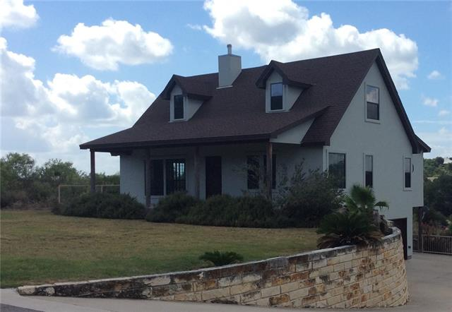 Minutes to Lake LBJ, this custom build home can be an awesome vacation property, air B&B, or a family dream home. The main level is located at street level and contains the master suite, kitchen (granite & stainless), living area, a half bath, and access to the balcony overlooking the pool and the Hill Country. The upstairs has the secondary bedrooms and a full bath to share.  On the lower level you will find the 2 car garage, a flex room, a full bathroom, and easy access to the lower deck and pool area.