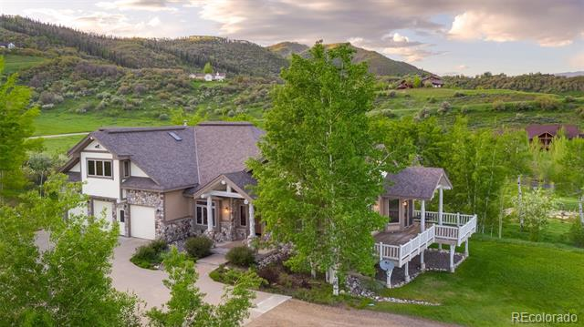 Custom home in Dakota Ridge with views of the Ski Area and the South Valley. The main level great room is a beautiful open space with vaulted ceilings, rock fireplace, and quarter sawn Oak floors with access to two large decks which are perfect for summer dining and extra entertaining space. The spacious master is just a few steps up from the main level and offers its own rock fire place, large walk-in closet, master bath with jetted tub, and private deck.  The generous kitchen has a large island workspace allowing for a few extra helpers during a large family gathering with granite counters, custom knotty pine cabinetry, pantry, quality appliances and a built-in desk space.  2 bedrooms upstairs are perfect for the kids, each with its own secret attic playroom and a desk area in the loft for homework. The lower walk-out level offers 3 more bedrooms, a large family area/game room with full wet bar, flex room with options for exercise, crafts or whatever along with tons of great storage.