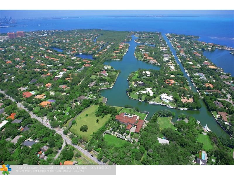 The LARGEST available waterfront residential parcel in ALL of Miami-Dade County! More than 3.51 acres and +/- 430 ft of deep-water dockage! Interior canal with added protection for larger vessels. Ample turning basin. The sparkling Atlantic Ocean is just a few minutes from the dock, with no fixed bridges. Located in Gables Estates, one of Miami's most exclusive residential enclaves. Membership application & approval required. NOTE: Currently vacant lot. Build plans available. Inquire for details.