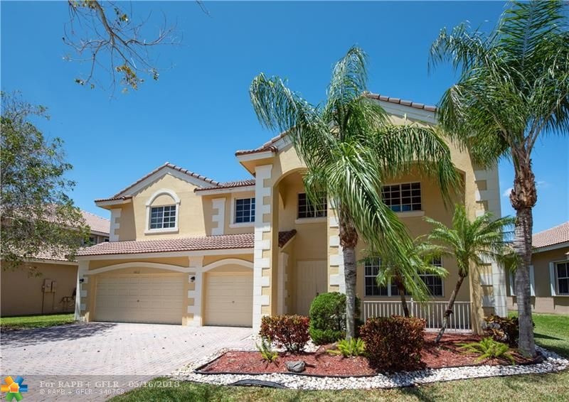 SUPERBLY REMODELED & VERY SPACIOUS HOME IN THE RESORT STYLE GATED COMMUNITY OF SAVANNA IN THE HEART OF WESTON. BEAUTIFUL POOL AREA WITH LAKE VIEW & LARGE COVERED SOCIAL PATIO. OVER $130K IN UPGRADES - REMODELED KITCHEN WITH WOOD CABINETRY & GRANITE COUNTER TOPS. ALL NEW XL PORCELAIN TILE DOWNSTAIRS & ALL NEW HARDWOOD FLOORS UPSTAIRS. NEW BASEBOARDS THROUGHOUT. EXTREMELY SPACIOUS FEATURING FIVE FULL BEDROOMS & 5 BATHROOMS PLUS HUGE BONUS/GAME ROOM UPSTAIRS AND A DEN/OFFICE OFF THE MASTER BEDROOM. CUSTOM WALK-IN CLOSETS IN ALL SUITE BEDROOMS. 2015 A/C UNITS, NEW 2019 POOL PUMP, CUSTOM LAUNDRY ROOM WITH X-LARGE WALL TO WALL COUNTERTOPS & CABINETRY.  WALKING DISTANCE TO COMMUNITY RECREATIONAL FACILITIES.  NOT TO BE MISSED!